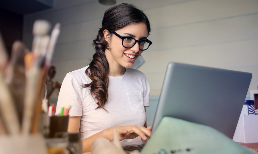 Smiling woman working on computer
